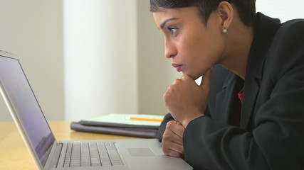 African American business woman using laptop computer