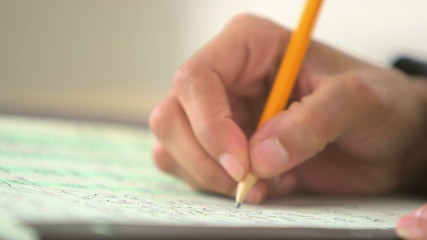 Close up of business woman writing with pencil
