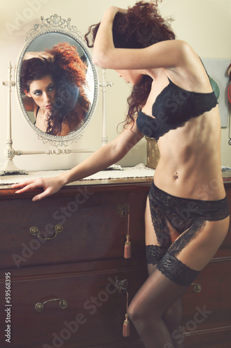 Sensual lingerie model reflected in the mirror