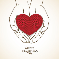 Love greeting card with human hands holding knitted heart