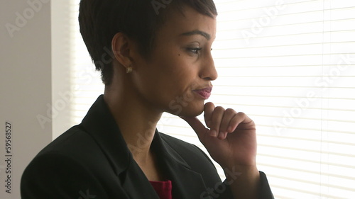 Close up of African American business woman thinking in office