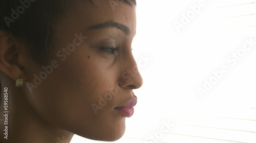 Close up of African American business woman thinking and looking