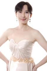 beautiful smiling woman in white gorgeous dress posing