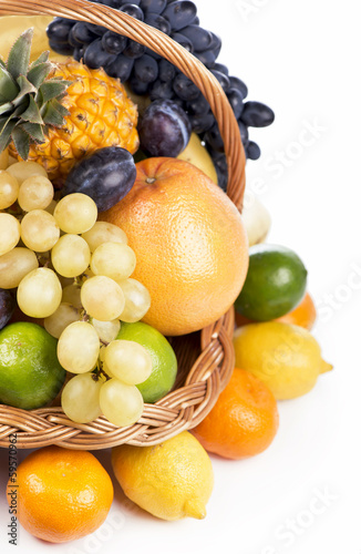 Fresh fruit in a wicker basket isolated on the white