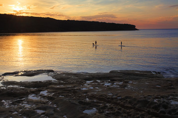 Paddle boarding on Botany Bay at sunrise