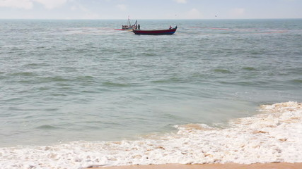 fisherman boats in sea - Kerala India