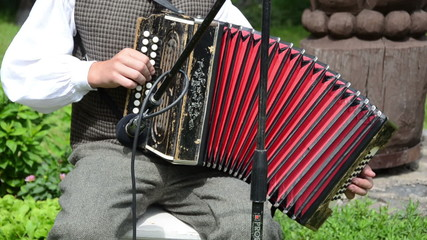 Accordionist man play rural folk country music with accordion