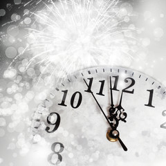 New Year's at midnight - old vintage clock and fireworks
