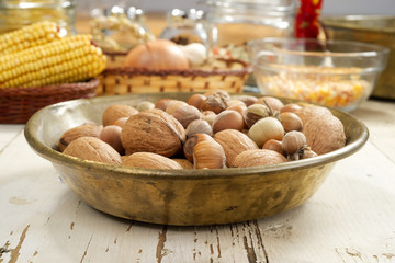 walnuts and hazelnuts on a copper tray