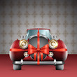 Vintage red car tied with red bow