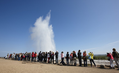 Iceland. South area. Golden Circle. Strokkur geyser with tourist