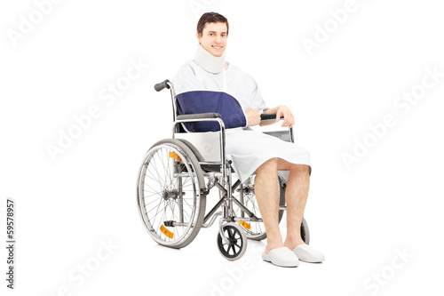 Disabled male patient with broken arm posing in a wheelchair