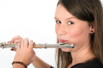 young woman playing transverse flute
