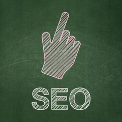 Web development concept: Mouse Cursor and SEO on chalkboard
