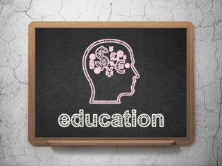 Education concept: Head With Finance Symbol and Education on