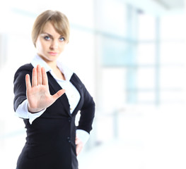 Blond businesswoman with stop hand sign gesture