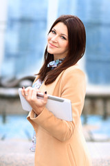 Businesswoman working on digital tablet out of office