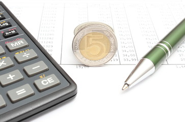 Money, pen and calculator lying on spreadsheet