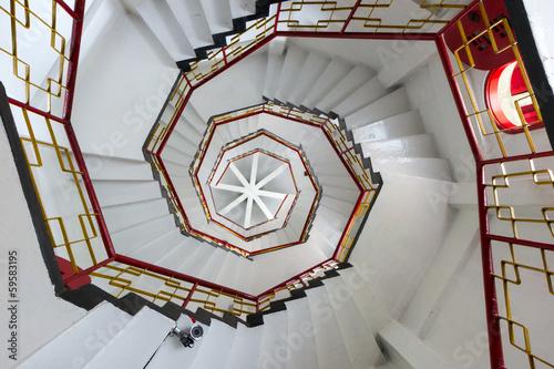 Upward view of white spiral stairways