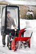 Man using snowblower