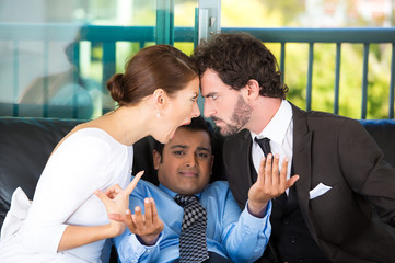 Man counselor caught in between fighting yelling couple