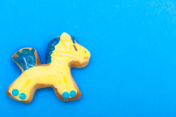 Christmas gingerbread cake pony icing decoration on blue