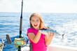Blond kid girl fishing tuna bonito sarda fish happy catch