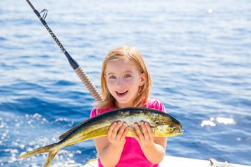 Blond kid girl fishing Dorado Mahi-mahi fish happy catch