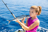 kid girl fishing tuna bonito sarda kissing fish for release poster