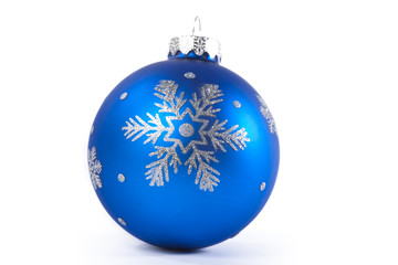 Close up shot of a blue Christmas ornament.