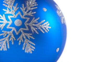 Macro shot of a blue Christmas tree ornament.