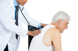 Doctor perfuming physical exam on elderly patient
