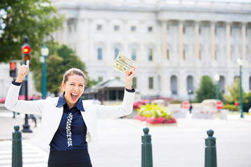 Corrupt politician in Washington DC, holding dollar bills