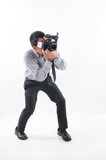 Professional male photographer taking picture, white background