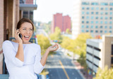 Happy business woman having conversation on a cell phone