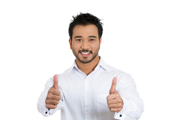 Successful businessman giving thumbs up