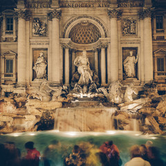 Vintage busy night at Trevi fountain, Rome