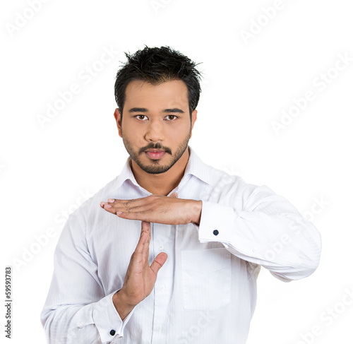 Serious man showing a time out gesture with hands