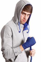Boxer pulls the bandage isolated on white background