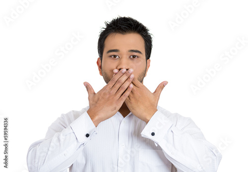 Man covering closed mouth. Speak no evil concept
