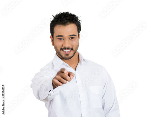 Young man, laughing, pointing  finger at someone