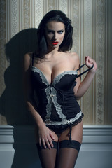 Sexy brunette woman at night