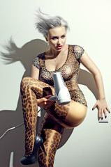 The crazy blond woman in leopard pants with hairdryer