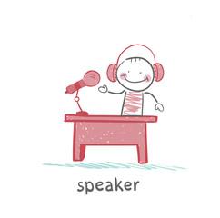 speaker of the headphones tells his desk