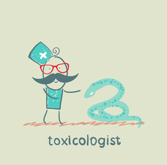 Toxicologist stands next to a snake