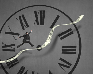 Businessman running on growing money trend with clock face