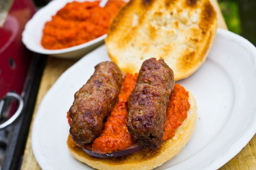 Cevapcici with ajvar in the grilled roll