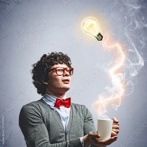 Young man with an electric bulb