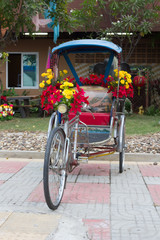 Bicycle Tricycle decorated with flowers