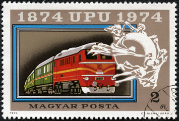 stamp printed in Hungary shows Mail train and UPU Emblem